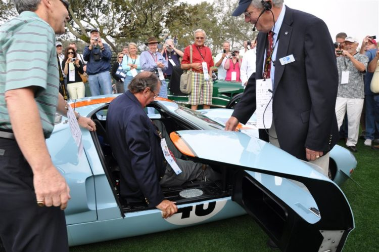 David Hobbs climbs out of the 1968 Ford GT40 Mk II Chassis 1074