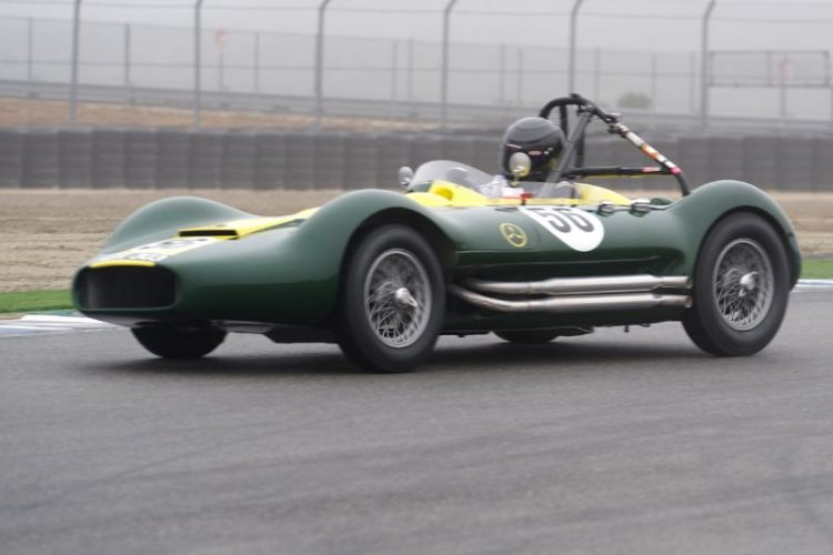 John 'Chip' Fudge's 1956 Lister Maserati on Saturday's damp foggy track.