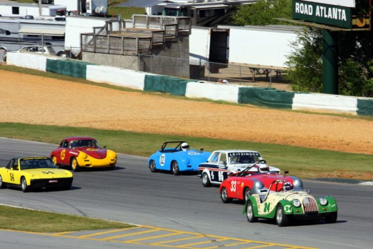 Stacey Schepens, 64 Morgan leads Tim Baker, Porsche 356, Butch Leitzinger, 69 Datsun 510, Dale Erwin, Porsche 256, Melvin Andrews, Porsche 914/6 and Ron Goodman through turn 1.
