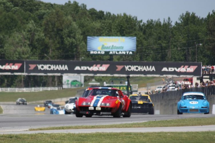 Michael Wallenfelsz, 69 Corvette leads a group of cars into turn one
