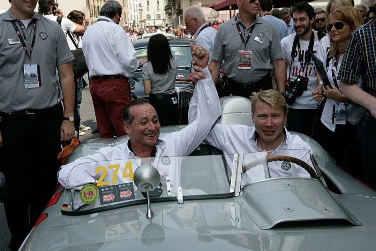 Mika Hakkinen and Juan Manuel Fangio II in Mercedes-Benz 300 SLR.