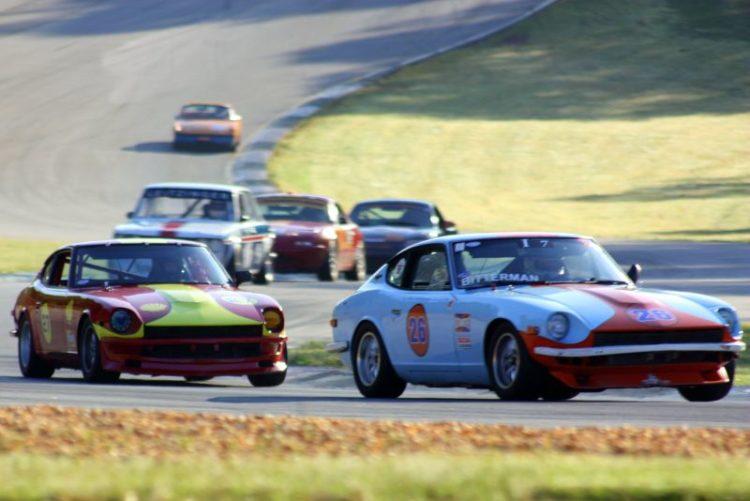 Robert Bitterman and Hayes Flynn driving their datsun 240 Z's through turn 5
