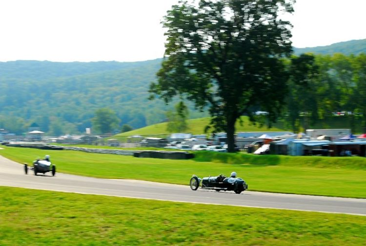 Chris Towner heads onto the front straight. 1938 Morgan F Type Trike.