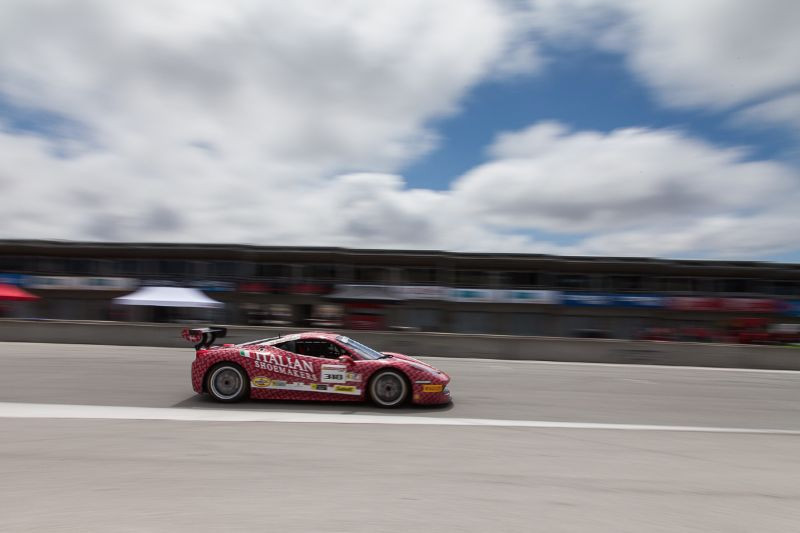 Gregory Romanelli races past the pit garages in the #318 Ferrari 458 EVO