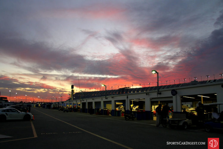 A lovely sunset blankets the garages at the speedway.