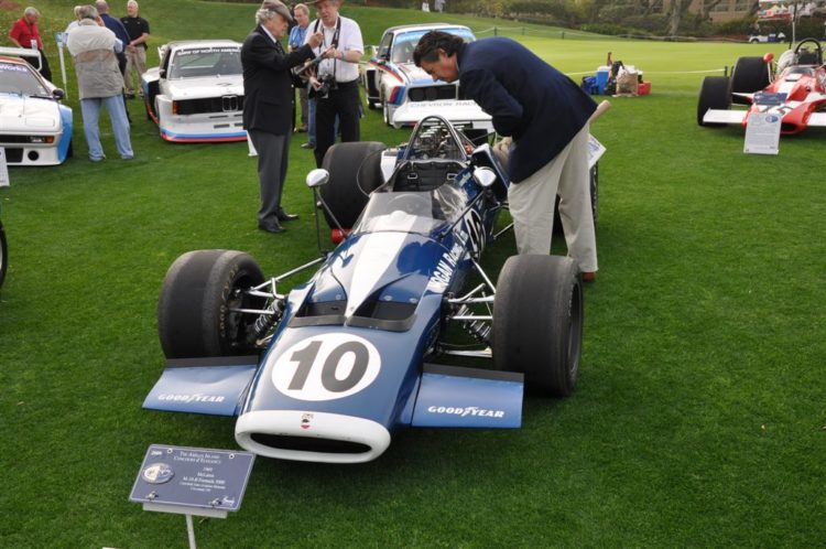 Bob Varsha inspects the 1969 McLaren M-10-B