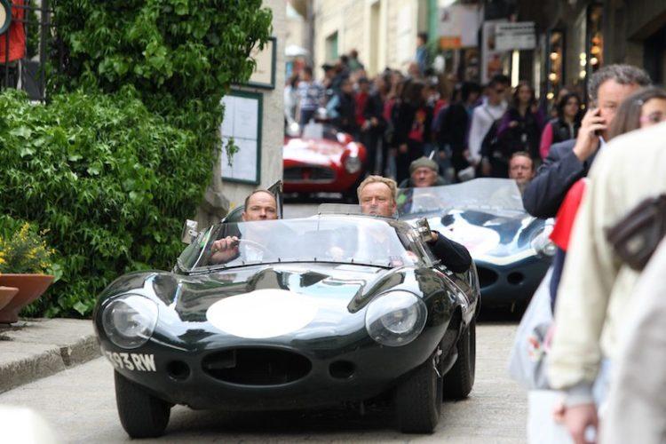 Two Jaguar D-Types navigate the crowd