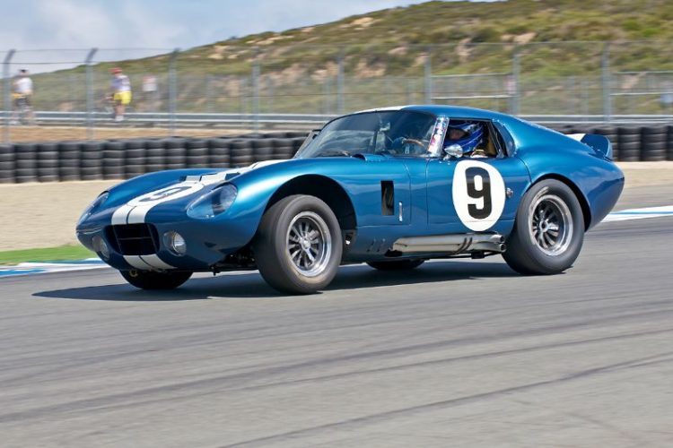 Rob Walton's 1965 Cobra Daytona Coupe accelerates out of turn Eleven.