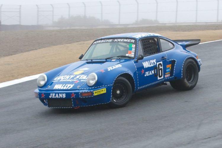Robert Newman's Porsche RSR on a wet track.