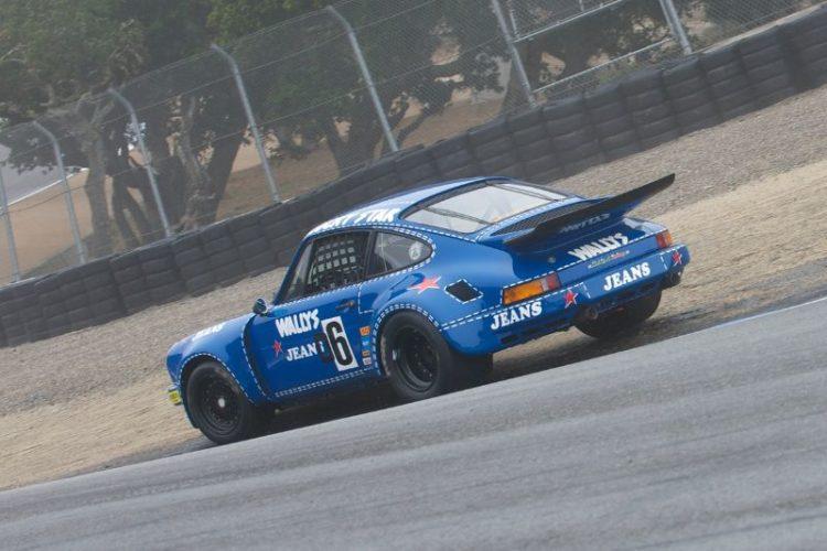 Porsche RSR of Robert Newman gets caught out on the wet track.