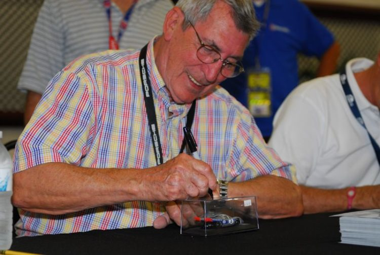 Vic Elford signs a die cast for a fan.