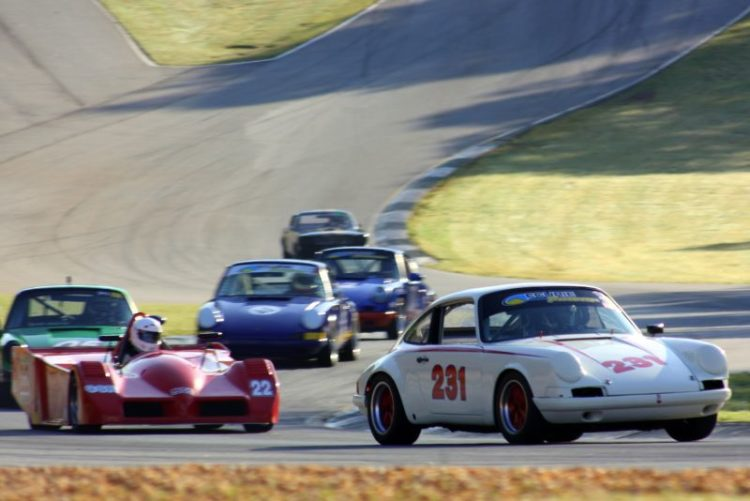 David Bland, 69 Porsche 911 leads a group of cars down the esses.