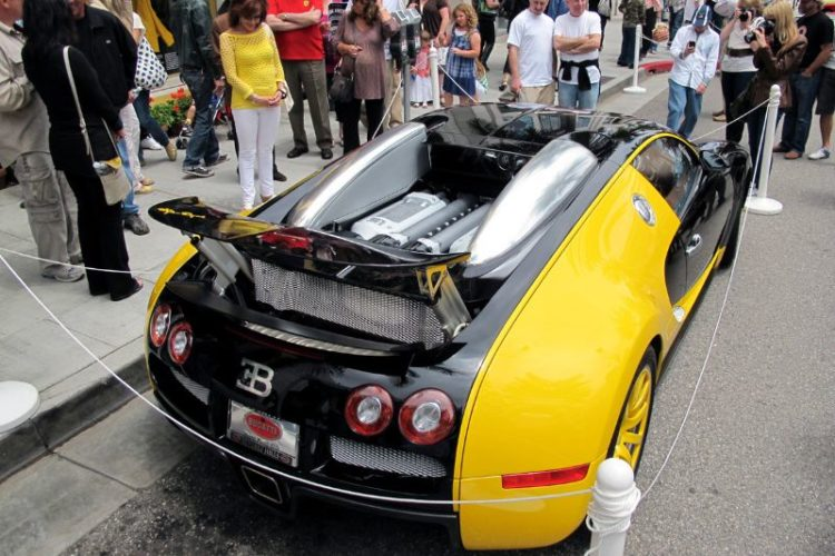 "The 1000-hp Bugatti Veyron always draws a crowd.  While this is not an Italian car, Bugatti's French founder, Ettore Bugatti, was born in Italy.  This is a special ""Bijan"" edition Veyron parked in front of … House of Bijan on Rodeo Drive."