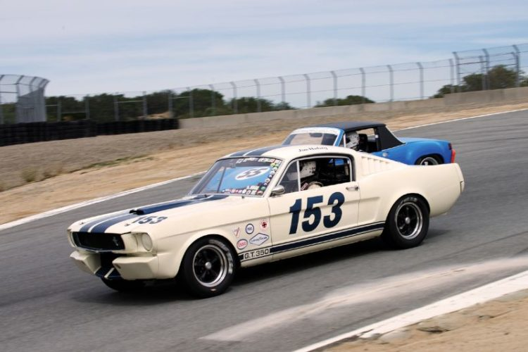 Jim Halsey's 1965 Shelby GT 350 leads Mark Leonard's 1970 914/6 into the Corkscrew.