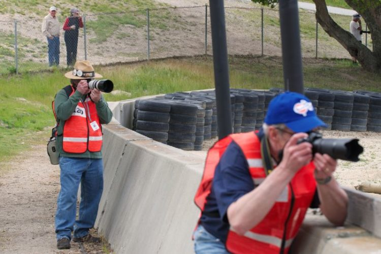 Two of the f8 Motorsports Photography Workshop students working the Corkscrew.