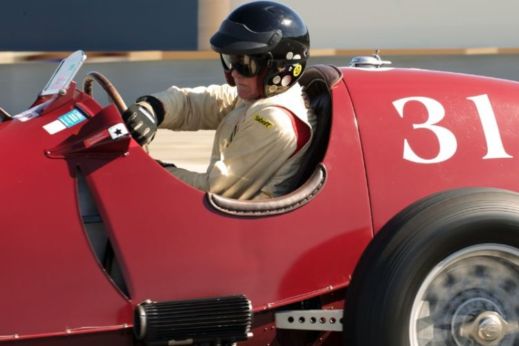 A study in concentration. Peter Giddings in his 1935 Alfa Romeo Tipo C 8C-35 in turn eleven.