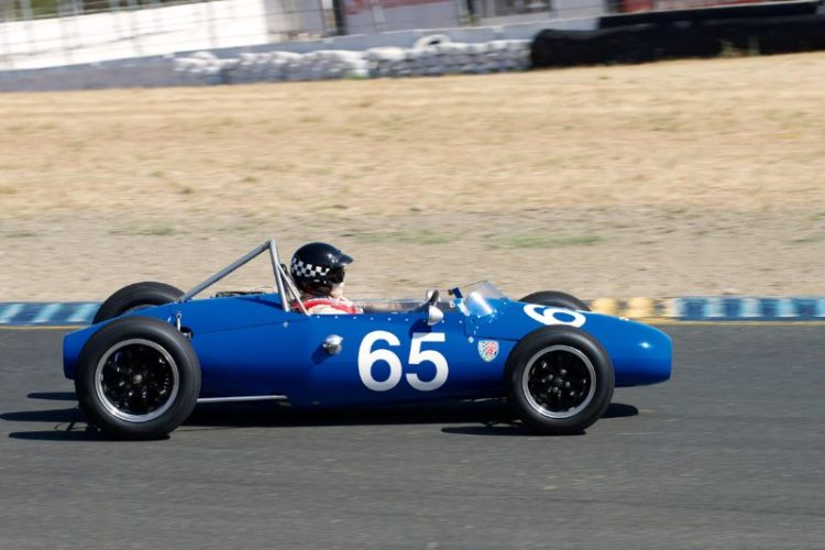 Between turns four and five is the 1960 Kieft F-Jr. driven by Marc Nichols.