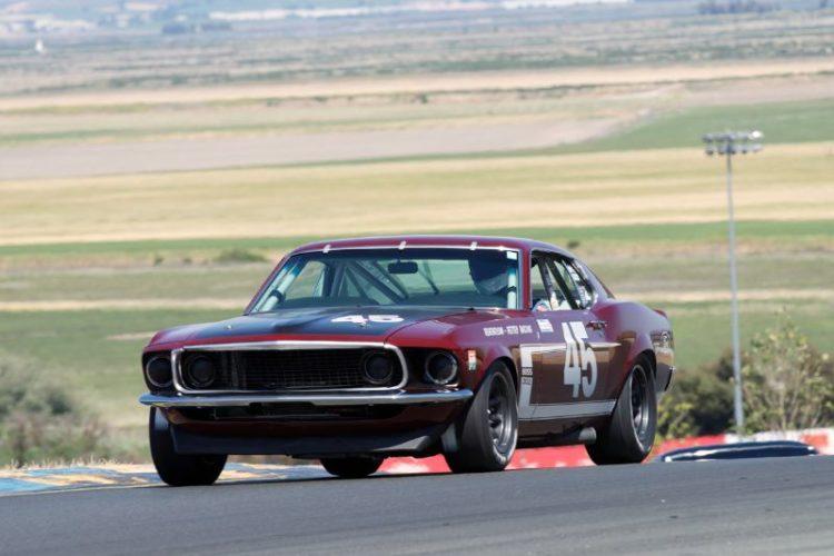 Ken Adams in his 1969 Boss 302 Mustang in turn two.