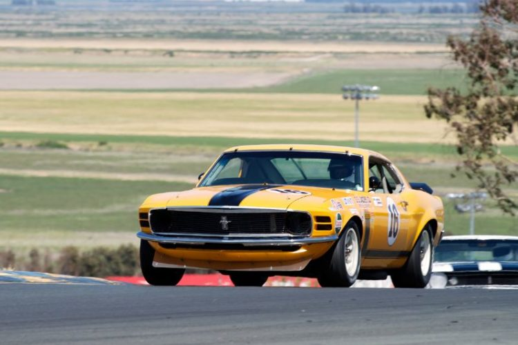 1970 Boss 302 driven through turn two by Jim Hague.