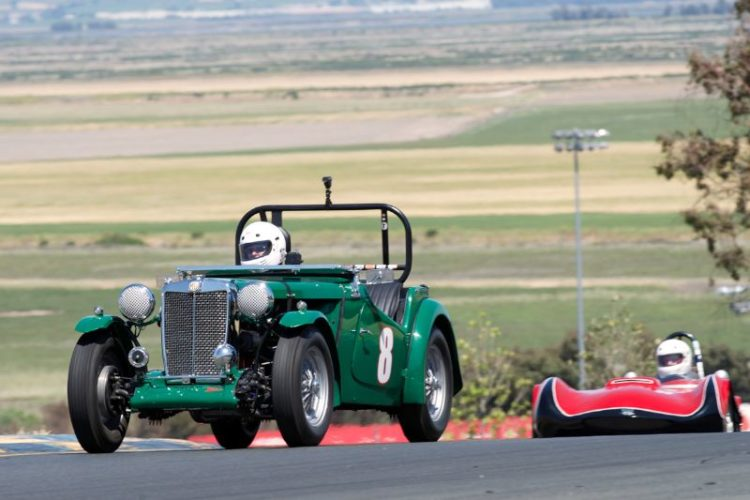 Jim Buell's 1949 MG-TC over the top of turn two.