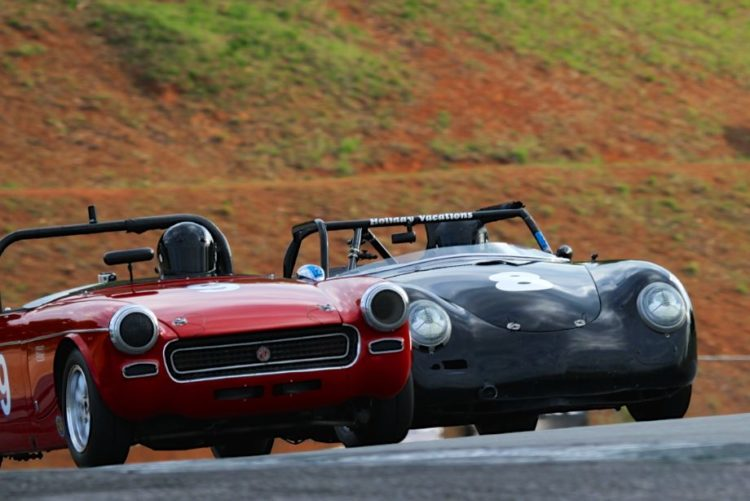 Paul Swanson, Porsche 356 passing Derek Chima, MG Midget as they exit turn 5.