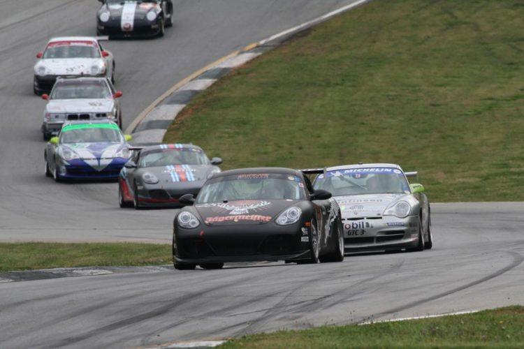 """Rodrigo Sales, 10 Cayman S, leads a line of cars through the """"Esses""""."""