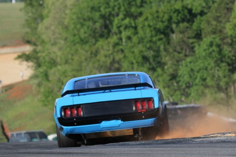 Curt Vogt kicks up dirt with his 70 Ford Boss 302.