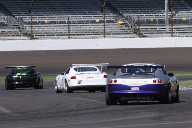 Three Panoz heading to the front straight.