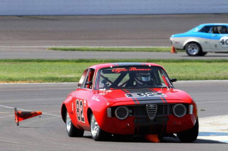 Bill Abel, 66 Alfa Romeo GTV discarding one of the cones he collected.