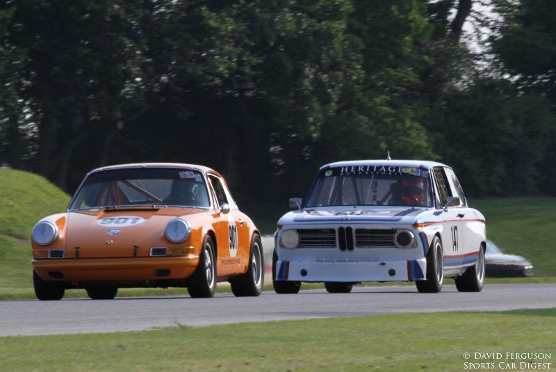 Justin Johnson, 69 Porsche 911 ahead of Russell Gee, 69 BMW 2002Tii.