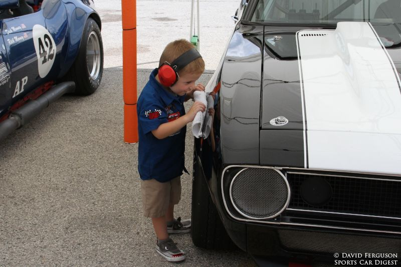 Starting young. This crew member was doing a great job cleaning the car until he discovered his reflection.