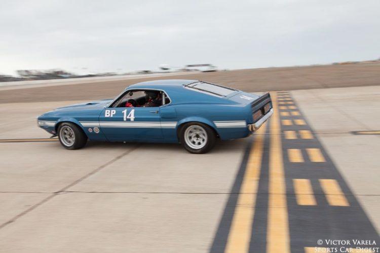 Andrew Alcazar in his 1969 Ford Boss 302 Mustang. © 2014 Victor Varela