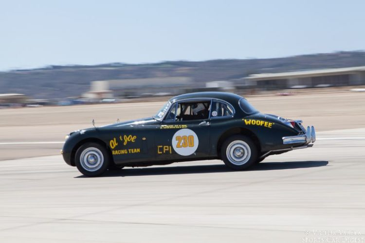 Al Waterhouse in his 1958 Jaguar XK150. © 2014 Victor Varela