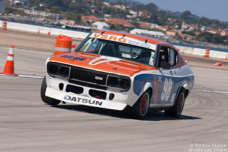 Jonathan Ornstein exits turn 9 in his 1973 Datsun 710. © 2014 Victor Varela