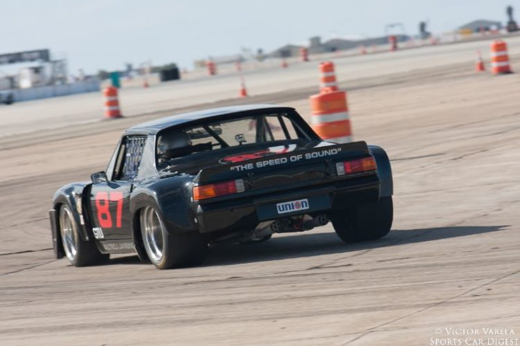 Bill Lyon handles turn 7 in his 1970 Porsche 914/6. © 2014 Victor Varela