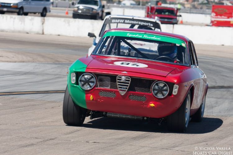 Anthony Covelli exits turn 11 in his 1966 Alfa Romeo Giulia Sprint. © 2014 Victor Varela