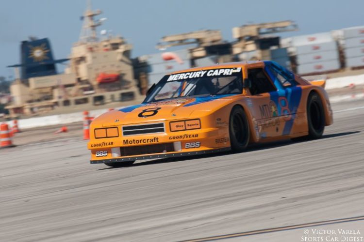 Ken Davis exits turn 9 in his 1985 Ford Mustang. © 2014 Victor Varela