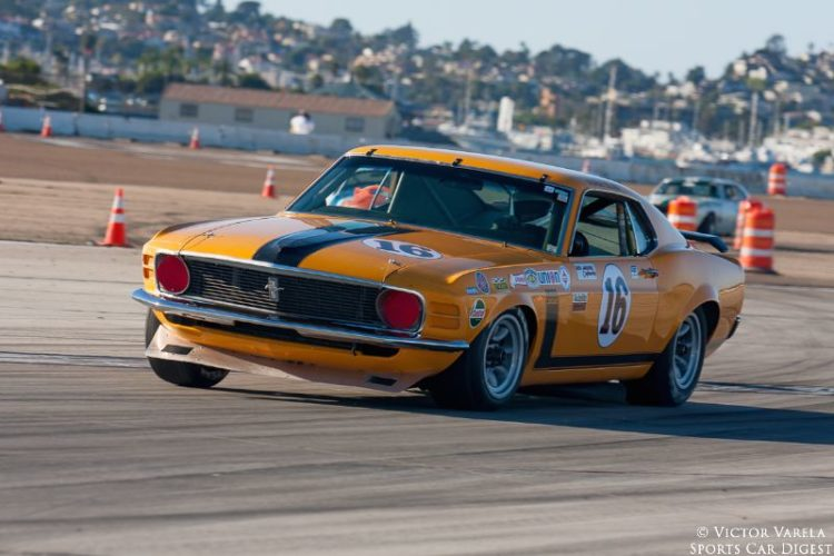 Chris Liebenberg in his 1970 Ford Boss 302 Mustang coming out of turn 9. © 2014 Victor Varela