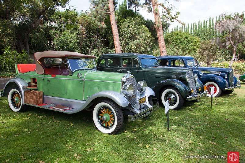 (L-R) 1928 Chrysler Model 72 Roadster, 1936 Packard Touring Sedan, 1940 Packard 120 4 Door Sedan