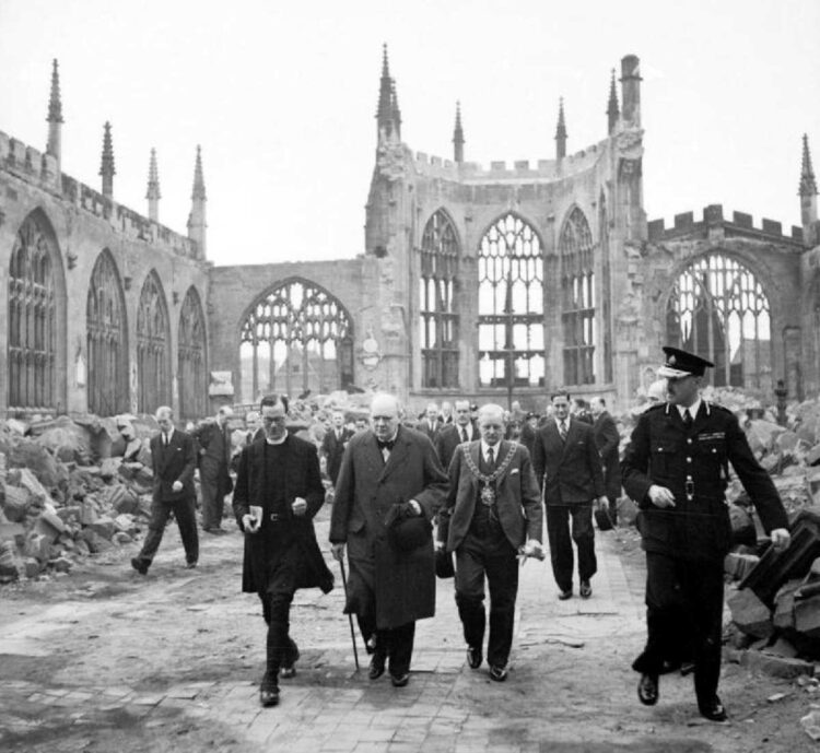 Winston Churchill strolling through damaged Coventry Cathedral