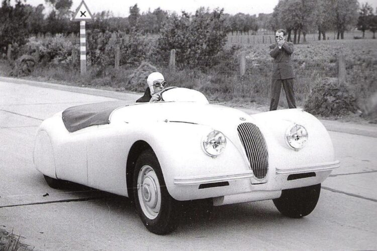 Ron 'Soapy' Sutton at the wheel of the 1949 Jaguar XK 120