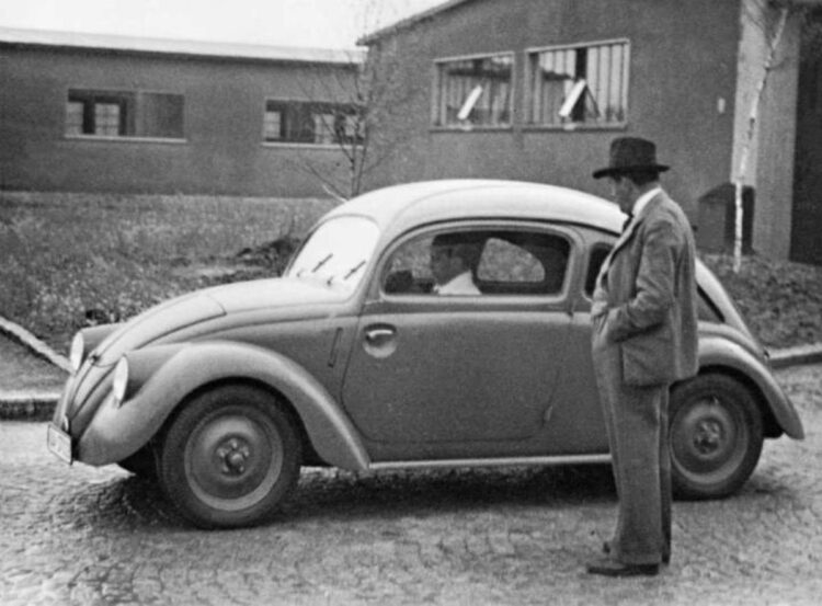 Ferdinand Porsche in front of a VW prototype