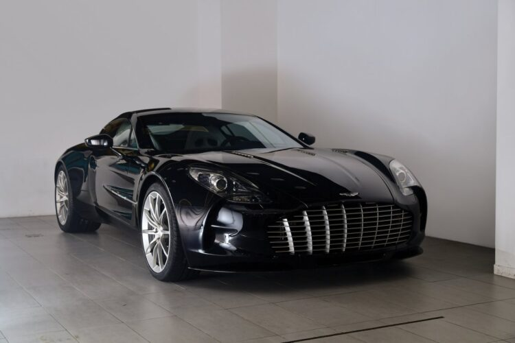 front of 2011 Aston Martin One-77
