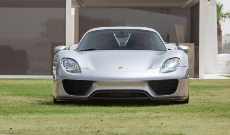 front of Porsche