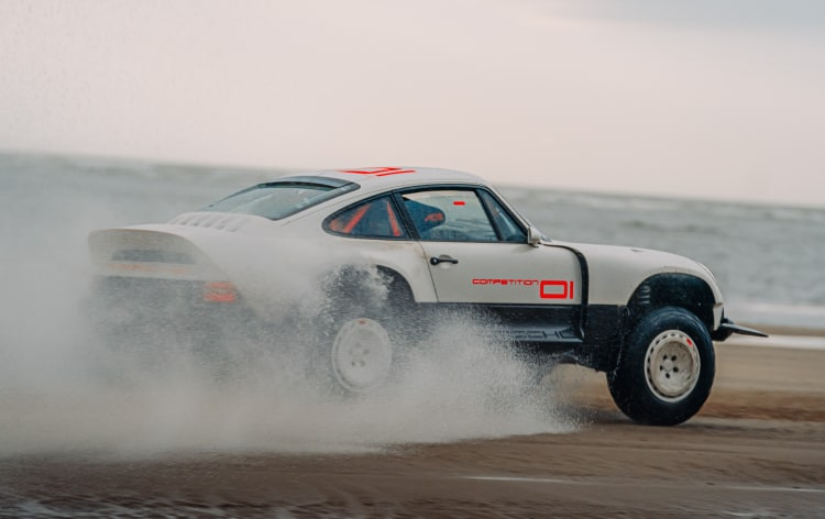 Porsche driving on beach