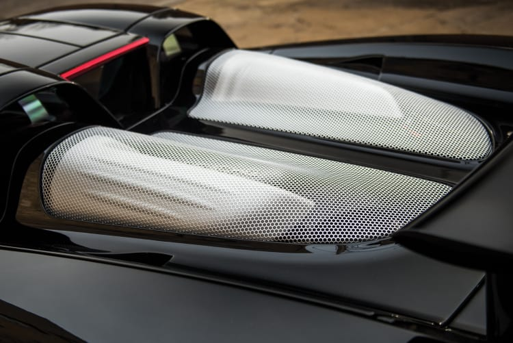 perforated stainless steel panels over engine