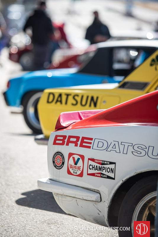 Group 4 racers line up in the hot pits at Laguna Seca during the HMSA races