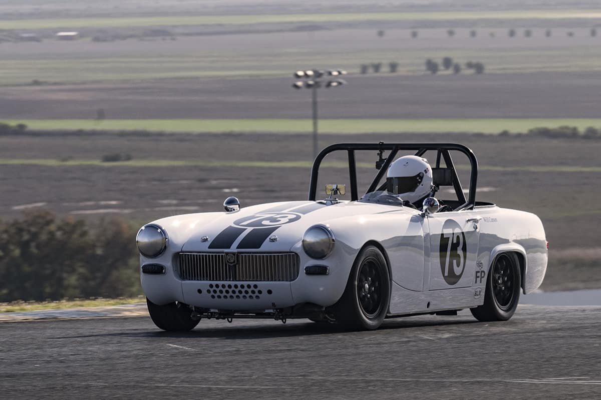 Will Carson - 1967 MG Midget acelerates out of turn two Saturday.