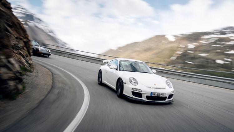 Porsche driving around mountain roads