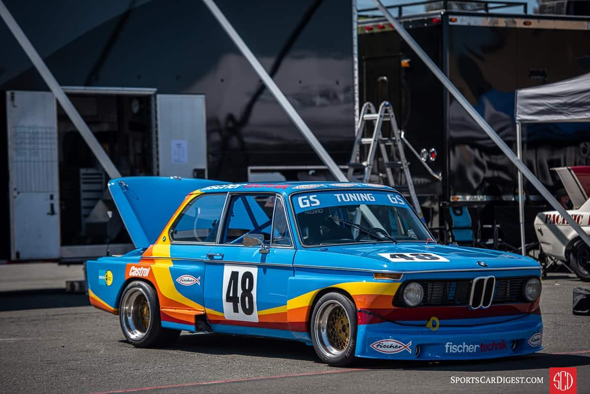 1975 BMW 2002 parked in the paddock at Sonoma raceway